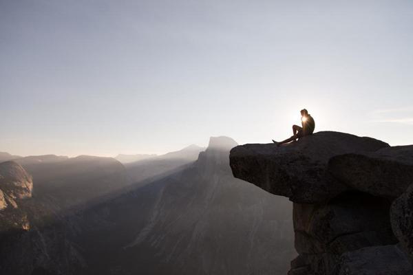 Man Sitting On Edge Beautiful Background